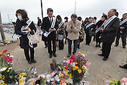 People perform a remembrance ceremony and pray at a shrine on Hiyori yama  or Weather Hill to remember victims of the tsunami at  Miyagi, Japan. Friday March 11th 2016. 2016 marks the fifth anniversary of the Great East Japan earthquake. This magnitude 9 quake caused a tsunami that flattened large parts of the Tohoku coast killing around 18,000 people and triggering a nuclear disaster at Fukushima Daichi Power Station.