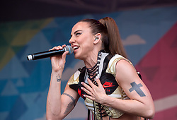© Licensed to London News Pictures. 13/07/2019; Bristol, UK. MEL C (Melanie Chisholm) from the Spice Girls performs with SINK THE PINK, at Bristol Pride's 10th anniversary festival in 2019; earlier there was their biggest ever march with thousands of people march in the Pride Parade through Bristol with the rainbow flag in celebration for all sections of the LGBT community. The festival continued on Bristol Downs with an estimated 35,000 people attending. Photo credit: Simon Chapman/LNP.