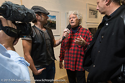 Biker Billy (Alfredo Cella) being interviewed in his gallery / Italian Choppers shop with an exhibition of photographs by Michael Lichter during EICMA, the largest international motorcycle exhibition in the world. Milan, Italy. November 20, 2015.  Photography ©2015 Michael Lichter.