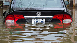 A flooded car is seen on Ile Bizard, Quebec, Canada., near Montreal, Monday, May 8, 2017. Photo by Paul Chiasson /The Canadian Press/ABACAPRESS.COM