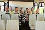 """24 MARCH 2004 - PHOENIX, AZ, USA: The Maricopa County juvenile chain gang waits on their bus to start work at a worksite in Phoenix, AZ, March 24, 2004. The juveniles volunteer to serve Maricpoa County Sheriff Joe Arpaio's chain gang. The sheriff, who claims to be """"the toughest sheriff in America,"""" has chain gangs in both the men's and women's jails and now has a chain gang for juveniles sentenced and serving time as adults in the county jail system. The sheriff claims it is the only juvenile chain gang in the country.   PHOTO BY JACK KURTZ"""