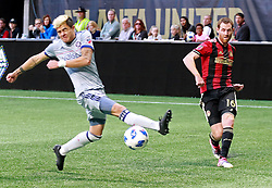 October 21, 2018 - Atlanta, GA, USA - Atlanta United's Chris McCann scores a goal past Chicago Fire midfielder Diego Campos to take a 2-1 lead during the first half on Sunday, Oct. 21, 2018 in Atlanta, Ga. The Atlanta United clinched a playoff spot with the victory. (Credit Image: © Curtis Compton/Atlanta Journal-Constitution/TNS via ZUMA Wire)