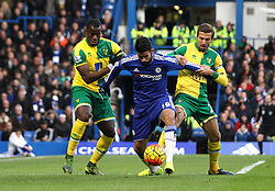 Diego Costa of Chelsea holds up the ball against Sebastien Bassong and Gary O'Neil of Norwich City - Mandatory byline: Robbie Stephenson/JMP - 07966 386802 - 21/11/2015 - FOOTBALL - Stamford Bridge - London, England - Chelsea v Norwich City - Barclays Premier League