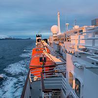 Last light illuminates the National Geographic Explorer as it navigates near the South Shetland Islands, Antarctica.