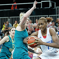 30 July 2012: Sandrine Gruda of France drives past Lauren Jackson of Australia during the 74-70 Team France overtime victory over Team Australia, during the women's basketball preliminary, at the Basketball Arena, in London, Great Britain.
