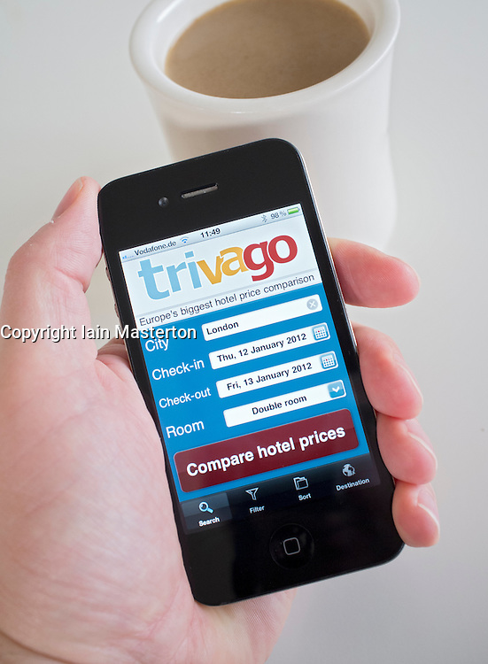 Booking hotel in London using Trivago online application on an iPhone 4g smart phone