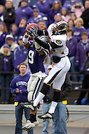 Missouri tight end Martin Rucker (R) pulls in a touchdown catch over Kansas State strong safety Kyle Williams (L), to give the Tigers a 7-0 lead in the first quarter at Bill Snyder Family Stadium in Manhattan, Kansas, November 19, 2005.  K-State defeated the Missouri Tigers 36-28.