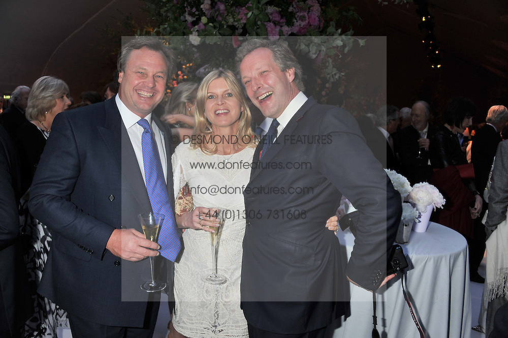 Left to right, The MARQUESS & MARCHIONESS OF MILFORD HAVEN and HUGO BURNAND at a dinner hosted by Cartier following the following the opening of the Chelsea Flower Show 2012 held at Battersea Power Station, London on 21st May 2012.