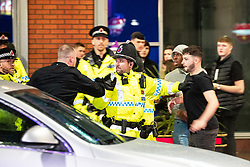"© Licensed to London News Pictures . 22/12/2018 . Manchester , UK . Police intervene after a fight breaks out outside The Birdcage nightclub on Withy Grove . Revellers out in Manchester City Centre overnight during "" Mad Friday "" , named for historically being one of the busiest nights of the year for the emergency services in the UK . Photo credit : Joel Goodman/LNP"
