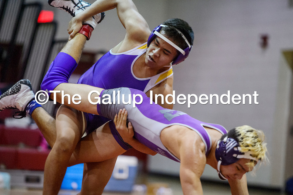 Kirtland Central Bronco Brandon Silago lifts the legs of Miyamura Patriot Isaiah Sanchez to drop him on the matt during the Four Corners Invite at Shiprock High School Wednesday.