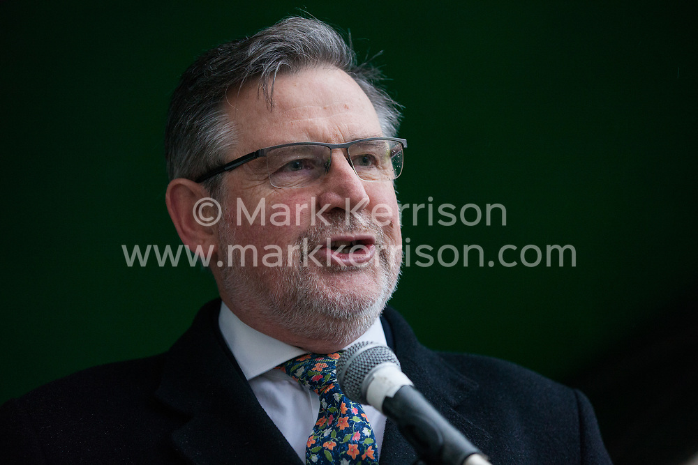 London, UK. 1st December, 2018. Barry Gardiner MP, Shadow Secretary of State for International Trade and Shadow Minister for International Climate Change, addresses the Together for Climate Justice demonstration against Government policies in relation to climate change, including Heathrow expansion and fracking. Following a rally outside the Polish embassy, chosen to highlight the UN's Katowice Climate Change Conference which begins tomorrow, protesters marched to Downing Street.