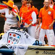 NLD/Amsterdam/20100807 - Boten tijdens de Canal Parade 2010 door de Amsterdamse grachten. De jaarlijkse boottocht sluit traditiegetrouw de Gay Pride af. Thema van de botenparade was dit jaar Celebrate, politicus Rita Verdonk