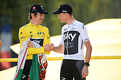 Tour de France 2018 winner Great Britain's Geraint Thomas (L), wearing the overall leader's yellow jersey, shakes hands with third-placed Great Britain's Christopher Froome (R) as they celebrate on the podium after the 21st and last stage of the 105th edition of the Tour de France cycling race between Houilles and Paris Champs-Elysees, in Paris, France, on July 29, 2018. Photo by Eliot Blondet/ABACAPRESS.COM