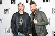 NASHVILLE, TENNESSEE - NOVEMBER 12: Chris Lucas and Preston Brust of LoCash attend the 67th Annual BMI Country Awards at BMI on November 12, 2019 in Nashville, Tennessee.
