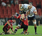 Brumbiues centre, Stirling Mortlock is lifted up in the air by Lions Hooker, Willie Wepener in the Super 14 match between the Lions and the Brumbies that took place on Saturday 21 March 2009 at Coca-Cola Park in Johannesburg South Africa. The Lions won this Super 14 match against the Brumbies 25 - 17.  <br /> Photographer : Anton de Villiers / SASPA