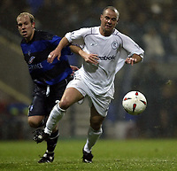 Photo. Aidan Ellis.<br />Bolton Wanderers v Gillingham.<br />Carling Cup 3rd Round.<br />28/10/2003.<br />Bolton's Stelios Giannakopoulos and Gillingham's John Hills battle for possesion.
