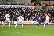 Oscar of Chelsea shoots and scores his teams 4th goal. Barclays Premier League match, Swansea city v Chelsea at the Liberty Stadium in Swansea, South Wales on Saturday 17th Jan 2015.<br /> pic by Andrew Orchard, Andrew Orchard sports photography.