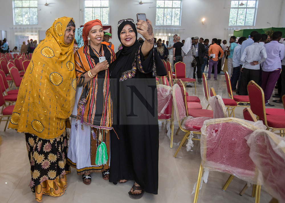 © Licensed to London News Pictures. 4/08/2015. Hargeisa, Somaliland. A group of young women take a selfie with a Somaliland singer during the International Hargeisa Book Festival in the city of Hargeisa within the Republic of Somaliland this week (1 - 6 Aug). <br /> <br /> Over 700 guests are expected to attend along with renowned poets, writers and musicians from both Somaliland, Nigeria and the UK.  As well as the book fair the Women of the World (WOW) event, hosted by Jude Kelly, the Artistic Director of the Southbank Centre in London was held for the first time in the Horn of Africa.   Photo credit : Alison Baskerville/LNP