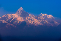 Machapuchare (Fishtail) and Annapurna III, peaks of the Annapurna Massif of the Himalayas, seen from Sarangkot,  near Pokhara, Nepal.