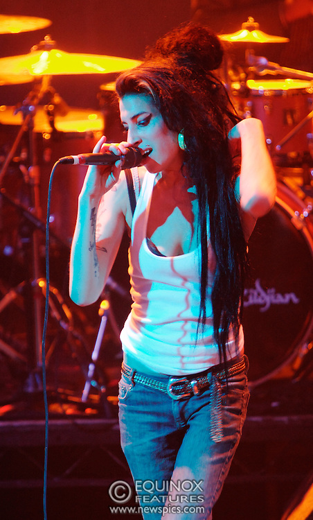 Singer Amy Winehouse, DOB=14/09/1983, performing for her gay fans at the G-A-Y Club. G-A-Y is London's biggest gay club and is held at the London Astoria nightclub, Soho, London, UK. Amy spent much of the show rubbing her itchy nose. She also seemed to have signs of old scars all down one arm...Picture Data:.Photographer: Edward Hirst.Copyright: ©2007 Licensed to Equinox News Pictures +448700 780000.Contact: Equinox Features.Date Taken: 20070415.Time Taken: 015533+0000.www.newspics.com