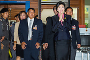 "09 JANUARY 2105 - BANGKOK, THAILAND: YINGLUCK SHINAWATRA, former Prime Minister of Thailand, walks into Parliament House in Bangkok for her impeachment trial. Thailand's military-appointed National Legislative Assembly began impeachment hearings Friday against former Prime Minister Yingluck Shinawatra. If she is convicted, she could be forced to stay out of politics for five years. During her defense, Yingluck questioned the necessity of her impeachment, saying, ""I was removed from office, the equivalent of being impeached, three times already, I have no position left to be impeached from."" A decision on her impeachment is expected by the end of January.    PHOTO BY JACK KURTZ"