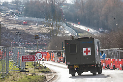 Harefield, UK. 13th February, 2021. A field ambulance is seen close to a road closure put in place to facilitate tree felling on Harvil Road in the Colne Valley for the HS2 high-speed rail project.