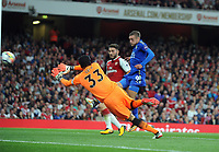 Football - 2017 / 2018 Premier League - Arsenal vs. Leicester City<br /> <br /> Jamie Vardy of Leicester scores goal no 2 pst Petr Cech at The Emirates.<br /> <br /> COLORSPORT/ANDREW COWIE