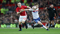 Football - 2016 / 2017 FA Cup - Fourth Round : Manchester United vs. Wigan Athletic <br /> <br /> Callum Connolly of Wigan Athletic and Luke Shaw of Manchester United during the match at Old Trafford.<br /> <br /> COLORSPORT/LYNNE CAMERON
