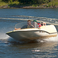 Ben and Nick Wiltsie drive a little boat called a Superdink on Lake of the Woods, Ontario, Canada.