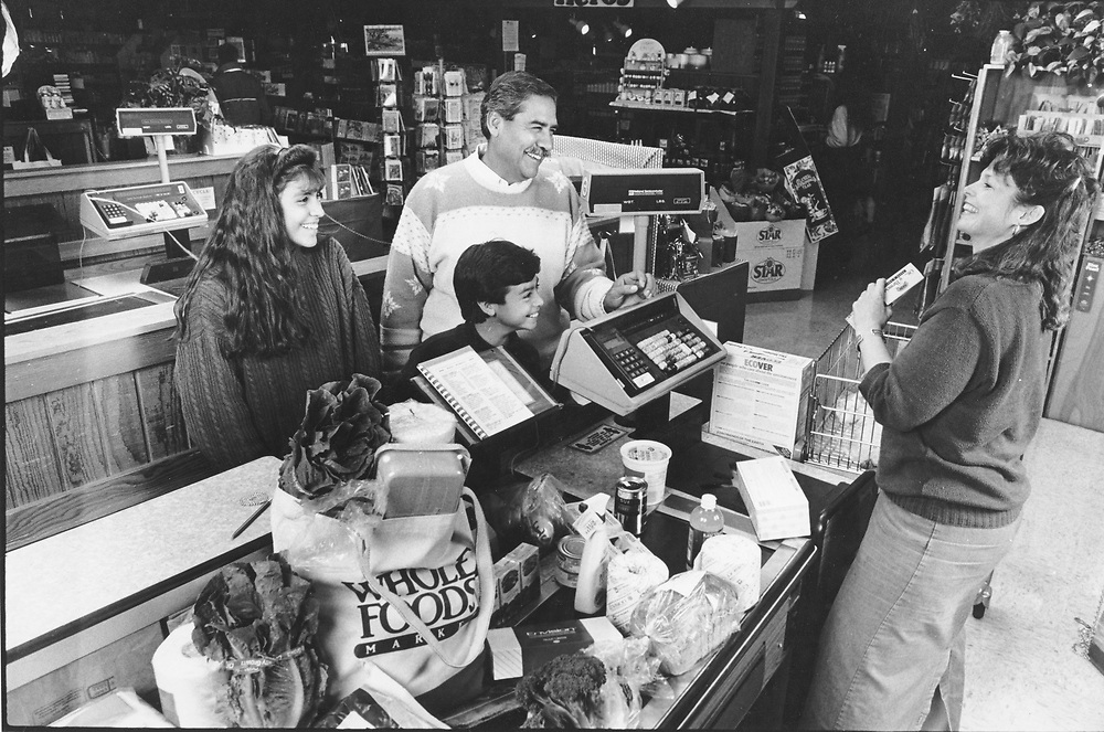 ©1990 Hispanic family grocery shopping at Austin, Texas health food store, Whole Foods. MR ES-0437 color available.