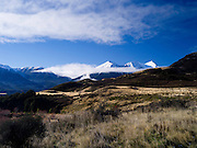 The Puketeraki Range rises above a brown grass paddock; New Zealand; June 2013