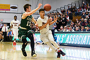 Rutland's Jamison Evans (21) loses the ball as he drives to the hoop past St. Johnsbury's Alex Carlisle (13) during the Vermont state division II boys basketball semifinal game between the St. Johnsbury Comets and the Rutland Raiders at Patrick Gym on Thursday night March 15, 2018 in Burlington. (BRIAN JENKINS/for the FREE PRESS)