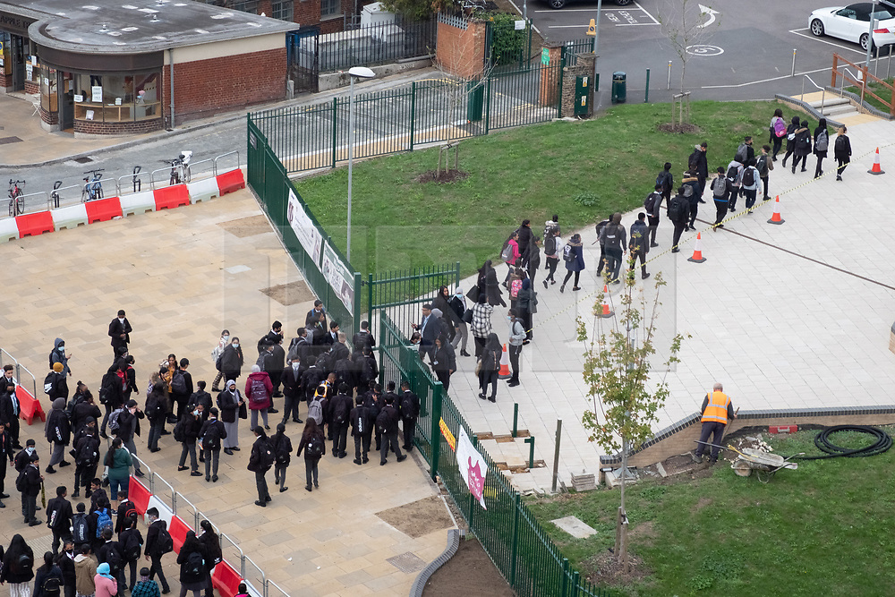 © Licensed to London News Pictures. 07/09/2020. London, UK. Pupils queue up and enter Alperton Secondary Community school for the first day of Autumn term as Covid-19 safety measures are implemented. Photo credit: London News Pictures