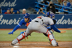 April 29, 2018 - Toronto, ON, U.S. - TORONTO, ON - APRIL 29:  Toronto Blue Jays Center field Kevin Pillar (11) dives safely home during the MLB game between the New York Yankees and the Toronto Blue Jays on April 29, 2018 at Rogers Centre in Toronto, ON. (Photo by Jeff Chevrier/Icon Sportswire) (Credit Image: © Jeff Chevrier/Icon SMI via ZUMA Press)