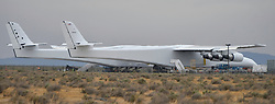 May 31,2017. Mojave Ca.  Paul Allen's Stratolaunch carrier makes it's first out of the hanger appearance Wednesday. The Stratolaunch  was rolled out to start fuel testing on it's tanks as Paul Allen sent out a aerial photo of it this morning. The plane is built by Scaled Composites and called the ''Roc,''  The plane has the longest wingspan of any aircraft ever built: 385 feet from tip to tip. The six-engine mothership is designed to carry rockets between its two fuselages. Once at altitude, the mega-plane will drop the launch vehicle, which will then fire its boosters and launch to space from the air..Photo by Gene Blevins/LA DailyNews/ZumaPress. (Credit Image: © Gene Blevins via ZUMA Wire)