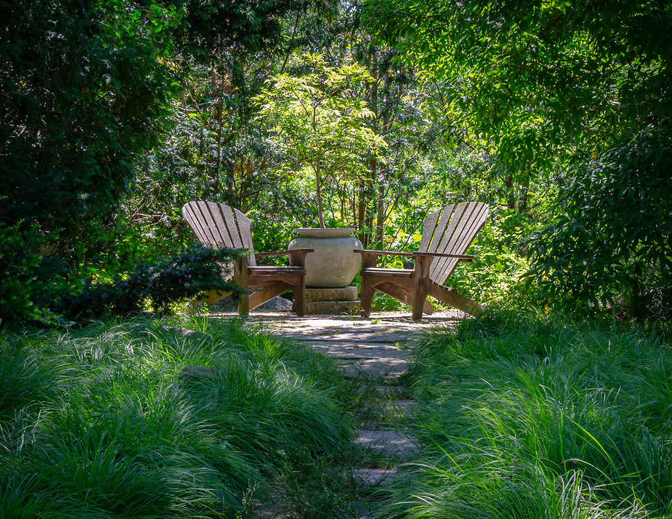 Adirondack Retreat, one of the quiet spaces to pause, rest and reflect on a warm spring day in the beautiful Olbrich Botanical Gardens, Madison, Dane County, Wisconsin.
