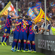 BARCELONA, SPAIN - August 25: Antoine Griezmann #17 of Barcelona celebrates with teammates after scoring his second goal of the match during the Barcelona V  Real Betis, La Liga regular season match at  Estadio Camp Nou on August 25th 2019 in Barcelona, Spain. (Photo by Tim Clayton/Corbis via Getty Images)