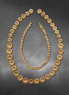 Mycenaean gold necklace from the Mycenaean cemetery of Midea tholos tomb , Dendra, Greece. National Archaeological Museum Athens. Grey art Background <br /> <br /> Inside mycenaean necklace has gold ivy leaf beads, Cat No 7354. The outer mycenaean necklace has rosette shaped gold beads, Cat No 7342. 15th-14th century BC. .<br /> <br /> If you prefer to buy from our ALAMY PHOTO LIBRARY  Collection visit : https://www.alamy.com/portfolio/paul-williams-funkystock/mycenaean-art-artefacts.html . Type -   Athens    - into the LOWER SEARCH WITHIN GALLERY box. Refine search by adding background colour, place, museum etc<br /> <br /> Visit our MYCENAEN ART PHOTO COLLECTIONS for more photos to download  as wall art prints https://funkystock.photoshelter.com/gallery-collection/Pictures-Images-of-Ancient-Mycenaean-Art-Artefacts-Archaeology-Sites/C0000xRC5WLQcbhQ