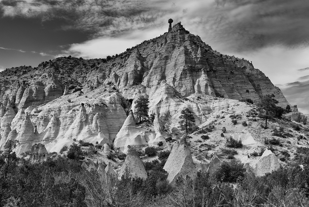 The unique sandstone formations that permeate the hills of Kasha-Katuwe Tent Rocks National Monument are seen in the afternoon light.