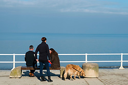 © London NewsPictures. 07/04/2017. Aberystwyth, UK. People walking their dogs on the promenade on a bright sunny spring morning  in Aberystwyth west Wales. High pressure dominates the weather in the UK, promising good weather and temperatures into the low 20s centigrade over  the coming weekend. Photo credit: Keith Morris/LNP