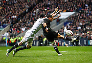 Picture by Andrew Tobin/SLIK images +44 7710 761829. 2nd December 2012. Tom Wood of England charges down Aaron Smith's kick during the QBE Internationals match between England and the New Zealand All Blacks at Twickenham Stadium, London, England. England won the game 38-21.