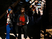 13 MARCH 2017 - PATAN, NEPAL: Pedestrians in late afternoon light near Patan's Durbar Square.     PHOTO BY JACK KURTZ