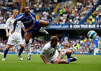 Photo: Richard Lane/Sportsbeat Images. <br />Chelsea v Birmingham. Barclay's Premiership. 12/08/2007. <br />Chelsea's Ashley Cole goes flying after a challenge by Birmingham's Stuart Parnaby.