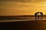Family enjoying sunset at 7 Mile Beach, Gerroa, NSW, South Coast, Australia