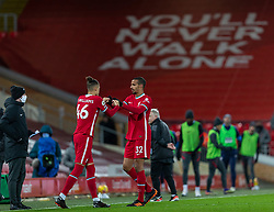 LIVERPOOL, ENGLAND - Sunday, December 27, 2020: Liverpool's Joel Matip goes off with an injury, replaced by substitute Rhys Williams, during the FA Premier League match between Liverpool FC and West Bromwich Albion FC at Anfield. The game ended in a 1-1 draw. (Pic by David Rawcliffe/Propaganda)