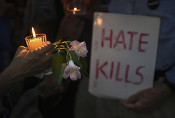 August 13, 2017 - Washington, DC, U.S - ''Charlottesville Solidarity Action'' holds a candlelight vigil in front of the White House in Washington, D.C.  Protests took place in many states following the violence and tragedy in Charlottesville VA on Saturday during a White Supremacist ''Unite the Right'' rally resulting in deaths and injuries. (Credit Image: © Carol Guzy via ZUMA Wire)
