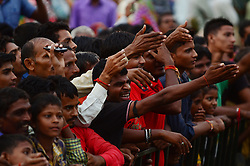 September 15, 2016 - Kaushambi, India - Indian local residents shouts after taking look of Indian Congress party's vice president and leader Rahul Gandhi during a public meeting, popularly known as Khaat Panchayats, where organizers make arrangement of thousands of Khaats (cots) for the people attending the meetings to sit on them, while listening to their leader, in tenwa village , in Kaushambi on September 15, 2016.Khaat (rustic Hindi word for cot) is symbol of villages in general and of farmers in particular. By naming the public meetings as Khaat Panchayats arranging khaats during the meetings, a strategy has been drawn to connect Rahul and Congress with the farmers of Uttar Pradesh and thus reap the electoral harvests during the next assambly elections. (Credit Image: © Ritesh Shukla/NurPhoto via ZUMA Press)