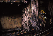 Firefighters assess charred remains damage of the Savoy Theatre fire, on 14th February 1990, in London, England. While the theatre was being renovated in February 1990, a fire gutted the building, except for the stage and backstage areas.
