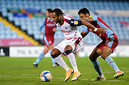 Bolton Wanderers Nathan Delfouneso (7) Scunthorpe United Jacob Bedeau (4) battles for possession during the EFL Sky Bet League 2 match between Scunthorpe United and Bolton Wanderers at the Sands Venue Stadium, Scunthorpe, England on 24 November 2020.