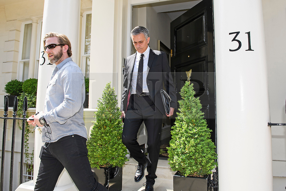 © Licensed to London News Pictures. 26/05/2016. London, UK.  JOSE MOURINHO (centre) leaves his home in west London amid ongoing speculation that he is due to be announced as the new manager of Manchester United Football Club. Photo credit: Ben Cawthra/LNP